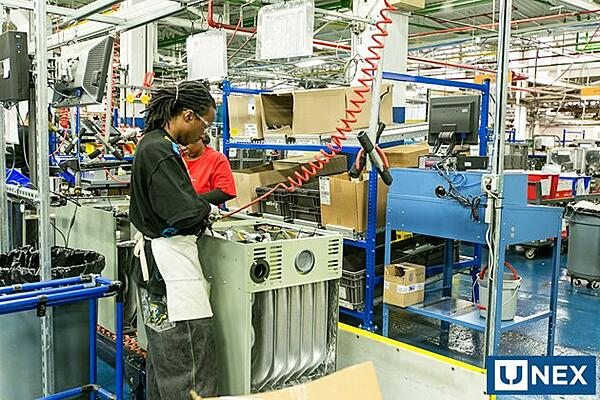 Assembly worker at Trane using a Flow Cell Workstation